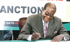 Zimbabwe President Robert Mugabe signing the petition that launched the anti-sanctions campaign which has been created by the western imperialist states designed to overthrow the ZANU-PF government. Mugabe attended the AU meeting on March 10, 2011. by Pan-African News Wire File Photos