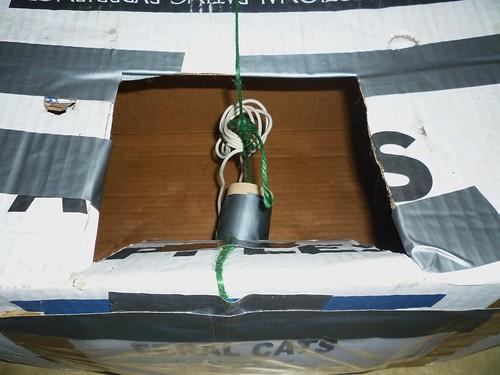 Step 1: Cut a hole in the box.