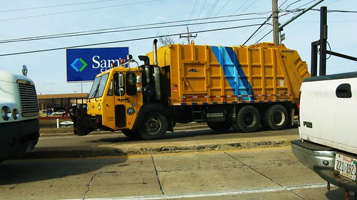 A large yellow CCC garbage truck. Des Plaines Illinois USA. Monday, March 14th, 2011. by Eddie from Chicago