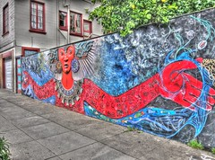 Mother Earth/Father Sky Neighborhood Goddess/God Mural, Handheld HDR (Walker Dukes) Tags: sanfrancisco california flowers blue red sculpture fish art water rain birds clouds canon mouth painting skulls skull eyes hand snake turquoise madonna sidewalk photographs oceans snakes diety photomatix tonemapped automaticexposurebracketing canons95