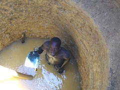 A man looks up from the bottom of the well