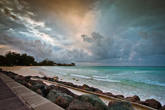 Cloudy Sunrise in Barbados (clee130) Tags: ocean travel blue sea sky orange sun storm beach water clouds sunrise canon landscape photography eos hotel rocks aqua day angle cloudy wide wideangle barbados usm 1022mm accra f3545 40d canon40d f3545usm accrahotel