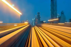 Receding Fast; The Dubai Metro (Mo Baig) Tags: city longexposure travel lowlight nikon long exposure dubai metro uae cities allrightsreserved 2011 d90 colorphotoaward nikond90 dubaimetro artlegacy thebestshot nikkor35mmf18afs doublyniceshot tripleniceshot flickraward5 mygearandme mygearandmepremium mygearandmebronze mobaig flickrawardgallery blinkagain bestofblinkwinners aboveandbeyondlevel1 aboveandbeyondlevel2