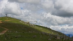 Gwen climbing out (overflow50) Tags: paragliding paraglider canberra spring springhill sky clouds