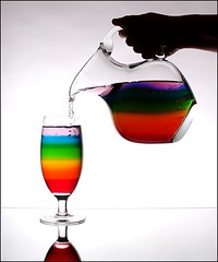 Pouring a Rainbow (Karen_Chappell) Tags: blue red stilllife orange white green glass yellow rainbow colours purple beverage jug pitcher pour liquid