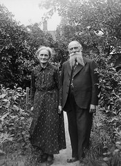 Mr and Mrs Nilsson, Kulladal, Skne, Sweden (Swedish National Heritage Board) Tags: woman man standing garden print beard outdoors thirties 1930s couple artist dress husband suit painter older wife pinstripe watchchain riksantikvariembetet theswedishnationalheritageboard