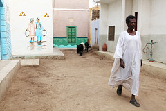 A man walking in the nubian village, Aswan, Egypt (Moon Flower MM) Tags: africa travel people house colors architecture photo colorful paintings egypt picture middleeast arab egyptian aswan  nubia nubian assuan