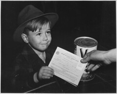 An eager school boy gets his first experience in using War Ration Book Two (The U.S. National Archives) Tags: bw food del child amor el worldwarii v8 nationalarchives ration mensajero whatscookingunclesam nara:arcid=535568
