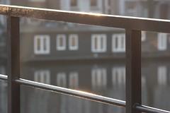 First sunlight (Kitty Terwolbeck) Tags: morning bridge sun sunlight water amsterdam river spring stedelijk brug railing lente zon stad amstel gracht spijlen rivier reling woonboot zonnestralen ochtendzon canalboot