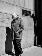 Behind you (misterbuckwheattree) Tags: light chicago man shadows loop cityhall cigarette streetphotography chicagoist