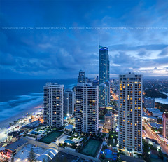 Gold Coast at dusk (Pawel Papis Photography) Tags: ocean street new city blue roof light sky urban cloud building tower beach water lamp skyline architecture modern night skyscraper town twilight downtown cityscape view apartment dusk district scenic wave australia landmark center scene aerial midtown queensland metropolis tall metropolitan tenniscourt goldcoast