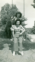 Two Women on Swing, 1940s (StevenM_61) Tags: vintage women duo snapshot swing blouse 1940s slacks foundphoto