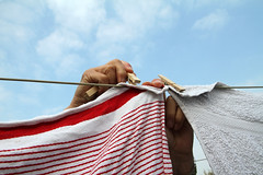 Hands pegging laundry on a washing line (!.Keesssss.!) Tags: sky people cloud netherlands horizontal closeup outdoors photography clothing holding day adult laundry hanging clothesline hygiene domesticlife chores adultsonly oneperson gettyimages clothespin drying partof royaltyfree colorimage onewomanonly humanhand humanbodypart theflickrcollection keessmans 208ksgetty