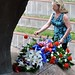 Mrs. Sarah Lynch lays a flower at the base of the Vietnam War's Battle of Hill 881 South monument during San Antonio Fiesta's All-Veterans Memorial Service