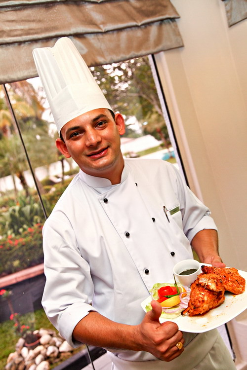 Chef Rakesh Maher from India with one of his creation from the Indian Food Festival - Tandoori Chicken