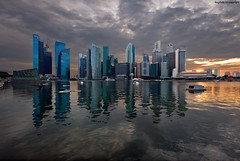Colors at the Marina Bay (Ragstatic) Tags: light sunset sky motion water skyline architecture marina buildings reflections bay nikon singapore exposure cityscape earth rags layers sands mbs d700