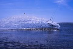 Just A Splash (A FUTURE FOTO) Tags: blue light sky sun white kite water canon island europe sweden board surfing april splash scandinavia f28 secretspot eos1 land markiii 1635mm