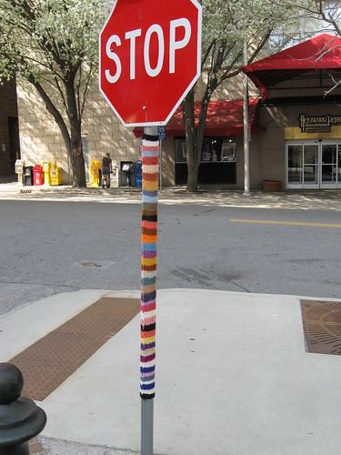 Yarnbombing a signpost in Berkeley