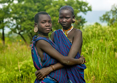 Teenage girls from Surma tribe - Ethiopia (Eric Lafforgue) Tags: africa people colour love horizontal youth outside outdoors person couple friendship artistic teenagers jeunesse ornament amour omovalley bodypainting ethiopia tribe rite surma personne humanbeing contemplation adornment afrique pigments tribu dehors omo eastafrica adolescents suri abyssinia ethiopie exterieur lookingatcamera 765 traditionalclothes waistup abyssinie vueexterieure coloredpicture photocouleur afriquedelest nomadicpeople surmatribe alataille etrehumain habittraditionnel tulgit suripeople valleedelomo peuplenomade regardantlobjectif turgit peoplesoftheomovalley surmapeople peuplesdelavalleedelomo villageofturgit villagedeturgit tribudessuri suritribe tribudessurma peuplesuri peuplesurma colouredpicture cadragealataille