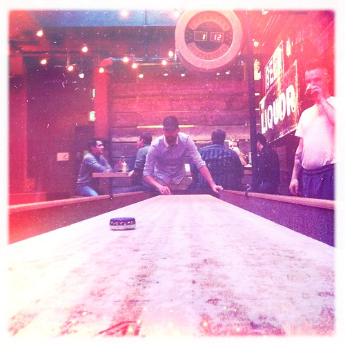 Joel playing shuffleboard