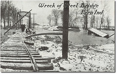 Wreck of railroad bridge, Peru, Indiana (Hoosier Recollections) Tags: people usa snow man men history industry peru walking bridges indiana transportation rivers pedestrians streams businesses railroads miamicounty 1913flood hoosierrecollections
