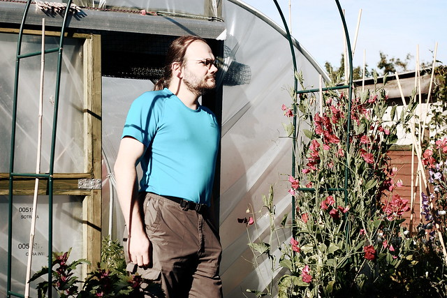 Wulf, standing in front of the garden polytunnel