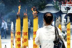The Fire That Burns (William J H Leonard) Tags: china portrait people woman fire person hongkong buddha candid buddhist prayer religion praying tian chinese tan buddhism incense tiantan monestary ngongping lantauasia