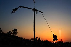 Silhouette Of The Swing (Satyaki Basu) Tags: street sunset people india silhouette festival canon eos indian swing 1750 tamron kolkata bengal calcutta bangla westbengal 450d charak gettyimagesmiddleeast