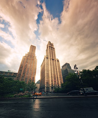 Woolworth Building (Philipp Klinger Photography) Tags: street new york city nyc newyorkcity trip flowers blue sunset summer vacation sky people urban usa sun holiday ny newyork storm reflection cars wet car rain clouds america skyscraper reflections evening coast us nikon warm unitedstates angle manhattan district taxi united unitedstatesofamerica north wide east woolworth rays states eastern financial philipp sigma1224mm thunder eastcoast woolworthbuilding klinger easternseaboa
