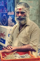 Fruits For Sale! (VinothChandar) Tags: portrait fruit vendor people market vegetables fruits sale sell apple apples pineapple orange guava spiritual color vibrant mango papaya chengalpattu chengalpet chennai tamilnadu india health healthy bindhi kumkum ash mustache beard white red colors tilak sacred portraiture look eyes determined indianportrait photo photography walk canon 5d markii detemination success failure hdr madras