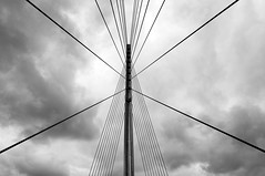 Strength (Dave Glad) Tags: bridge blackandwhite storm lines minnesota clouds shapes angles minneapolis engineering symmetry cables symmetrical twincities suspensionbridge midtowngreenway hiawathaave d5000 sabobridge nikond5000 cablestayedsuspension