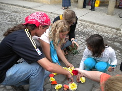 Brandon Waggy, Kathryn Ennes, Rachel Hershey, and Isabel putting together an alfombra outside our hotel