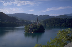 Bled (Cthonus) Tags: lake church geotagged slidefilm livejournal slovenia scanned analogue slovenija sweep pregame lakebled julianalps blejskiotok bledisland churchoftheassumption republikaslovenija cerkevmarijinegavnebovzetja blejskojezero julijskealpe pilgrimagechurchoftheassumptionofmary pregamesweepwinner pregameduelwinner firstpostchooseslittleislands