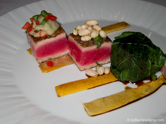Black pepper crusted bluefin tuna with sea salt, apple guava vinaigrette, and white bean salad.