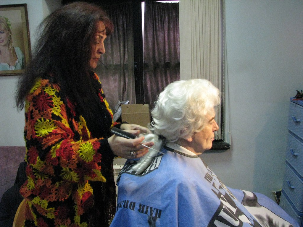 Make-up artist attends to Almaviva's wig