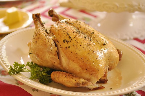 Roasted Chicken on a white platter garnished with parsley