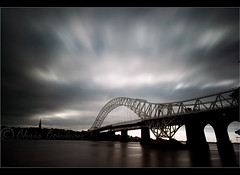 Dark Days..... (Chrisconphoto) Tags: longexposure bridge clouds dark movement mood moody darkness impact merseyside widnes ndfilter runcornbridge weldingglass