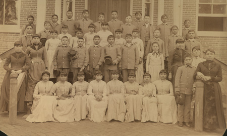 """Photograph of class of 40 Sioux Indian students Sent in April 1890 from Fort Peck Mont. Agency school to Carlisle - They were all volunteers - three have since returned on account of failing in health - the others are doing nicely and are contented."" Thomas Donaldson collection. Penn Museum image #174374"