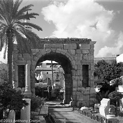 Marcus Aurelius Roman Arch Tripoli Old Town, Libya (Anthony Cronin) Tags: 6x6 analog square photography ancient ruins all arch marcus roman rights souk neopan agfa libya tripoli reserved romanempire aurelius folders agfaisolette leptismagna xtol isolette foldingcamera 500x500 streetsphotography fujineopan greensquare solinar libyans agfaisoletteiii film:iso=400 kodakxtol film:brand=fuji formatfolding january2011 anthonycronin filmdev:recipe=5418 developer:brand=kodak developer:name=kodakxtol film:name=fujineopan400 iiicolor skoparmedium camera6x6120filmdevrecipe5418fuji neopankodak xtolfilmbrandfujifilmnamefuji 400filmiso400developerbrandkodakdevelopernamekodak tripolisouk tpastreet tripolioldtown analog© streetphotographyagfa photangoirl