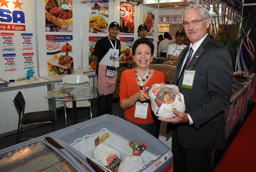 Acting Under Secretary for Farm and Foreign Agricultural Services, Michael Scuse, meets with Magaret Say of the USA Poultry Export Council's Singapore office at the 11th Food and Hotel Indonesia show in Jakarta April 6. As part of the U.S. Agribusiness Trade and Investment Mission to Indonesia this month, Scuse helped open the show, toured the floor and met with U.S. exhibitors. (Photographer, Rifky Suryadinata, U.S. Embassy, Jakarta)
