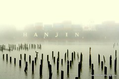 Morning Fog (Robert_Brown [bracketed]) Tags: county bridge red brown building robert fog oregon canon river rebel ship columbia cargo astoria pilings shipping hanjin megler clatsop