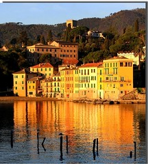 San Michele di Pagana (meghimeg(temporarily disconnected)) Tags: sea sun house reflection sunrise riviera mare colours alba seagull liguria case pole sole pali colori gaviota gabbiani riflesso 2011 borgomarinaro sanmicheledipagana
