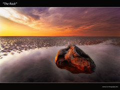 """The Rock"" (awhyu) Tags: sunset sky cloud seascape reflection rock reflections bay sand glow mud lancashire ripples morecambe waterscape"