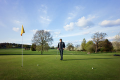 (dav) Tags: uk trees portrait england sky people green clouds ball golf landscape europe flag sony peeps 16mm gt40 leatherhead golfclub nex pachesham nex5 sonynex dav pacheshampark