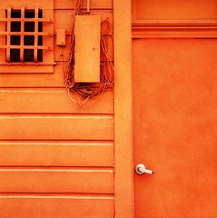knock if you like orange (msdonnalee) Tags: door orange window facade puerta fenster entrance doorway wires porta janela porte fachada entry frill utilitybox finetre mygearandme