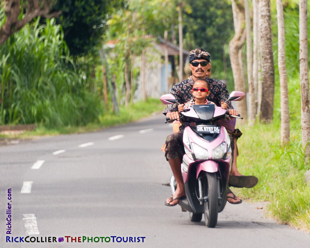 A family commutes from their temple, on the highway in Bali, Indonesia