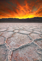 Fire & Ice (Laura A Knauth) Tags: california park red sky orange usa brown sun white mountains laura ice nature yellow clouds sunrise canon lens landscape fire photography nationalpark patterns hexagonal salt basin tokina national valley nd deathvalley grad rev formations badwater saltflat badwaterbasin deathvalleynationalpark 50d knauth lauraknauth