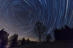 Viktorsberg Star Trails - [EXPLORED] (andreaskoeberl) Tags: mountains tree night dark bench stars feldkirch lowlight nikon tripod 1020 stitched startrails starrynight sigma1020 viktorsberg d7000 nikond7000 andreaskoeberl