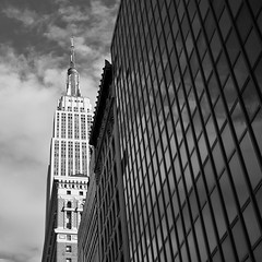 At 80, the Empire State Building strikes back (SGCampos) Tags: life street city newyorkcity light urban bw usa white newyork black building window architecture landscape us nikon traffic state empirestatebuilding may1 d90 80yearsold skycreeper sgcampos sgcam