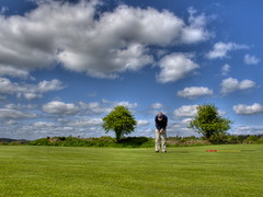Trying to hole out (Pat Kelleher) Tags: blue ireland sky white tree green grass canon golf cork course g12 justclouds